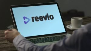 reevio logo and text on the screen